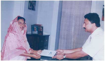 Receiving the Award of Excellence from Her Excellency Ms. Fathima Beevi, Governor of Tamil Nadu