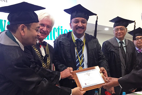 Dr. A. Kumar Swamy placing the Presidential Collar on President Dr. S.M. Balaji. Also seen are Dr. Phillip Dowell, UK, ICD International President & Dr. Rajiv Chugh, Secretary General, ICD