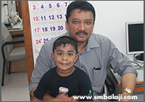 The Child With Dr. S.m. Balaji After Dental Implant Surgery