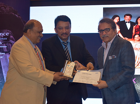 """Dr. Balaji and Dr. Meshram presenting Dr. Sandesh Mayekar with a Certificate of Appreciation at the end of Dr. Mayekar's keynote speech """"Functional Smile Designing"""" at the conference"""
