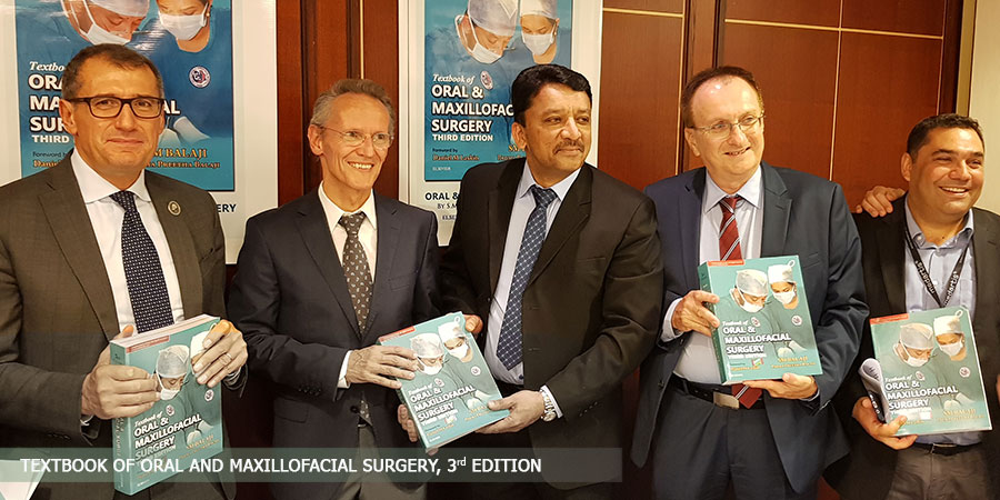 Prof SM Balaji presenting Prof Dr Klaus Dietrich Wolff with a copy of the Textbook of Oral and Maxillofacial Surgery at the inauguration ceremony.