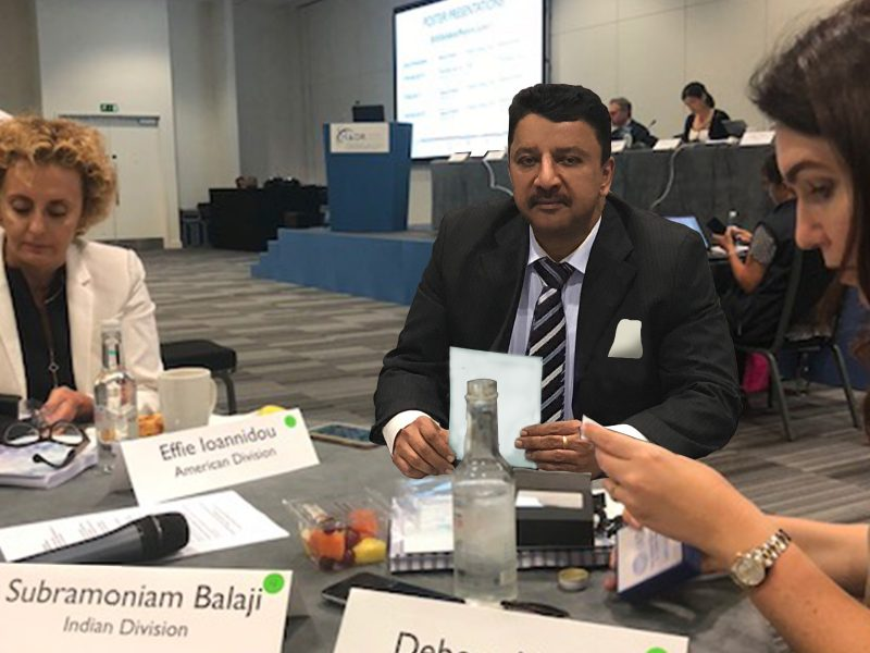 Dr SM Balaji seated with delegates at the IADR Council meeting