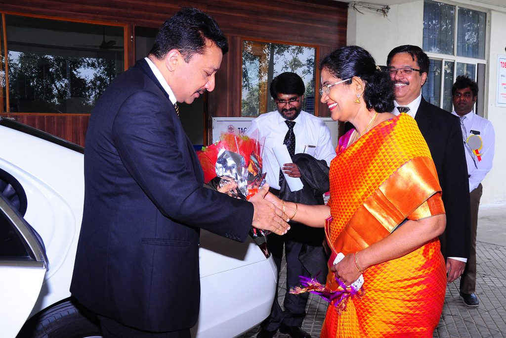 Prof SM Balaji being warmly greeted upon arrival at the college by senior staff members