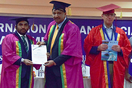 Dr SM Balaji receives certificate from minister