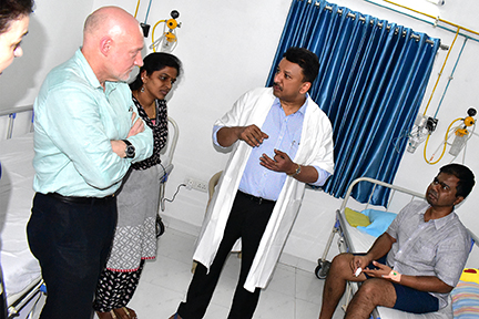 Dr SM Balaji's tour of the hospital included ward rounds where the visitors met with patients currently undergoing treatment